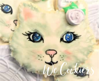 Kitty cookie. Decorated by water coloring with food gels.